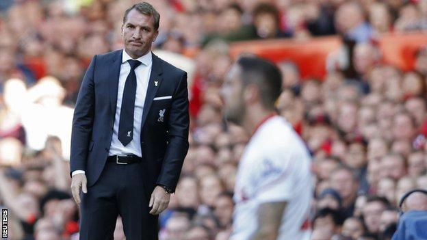 Brendan Rodgers looks on as Danny Ings falls to his knees