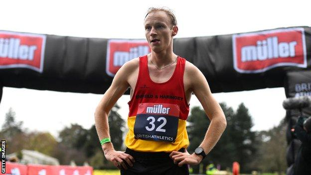 British race walker Callum Wilkinson puts his hands on his hips after winning the 20km walk at the British Olympic trials outside the Olympic qualifying time