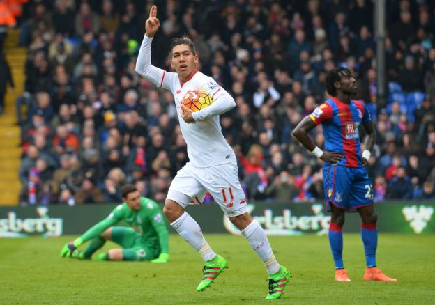 Roberto Firmino celebrates after scoring Liverpool's equaliser