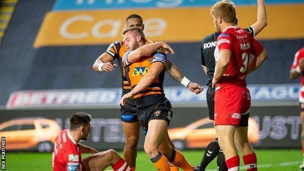Danny Richardson celebrates his try