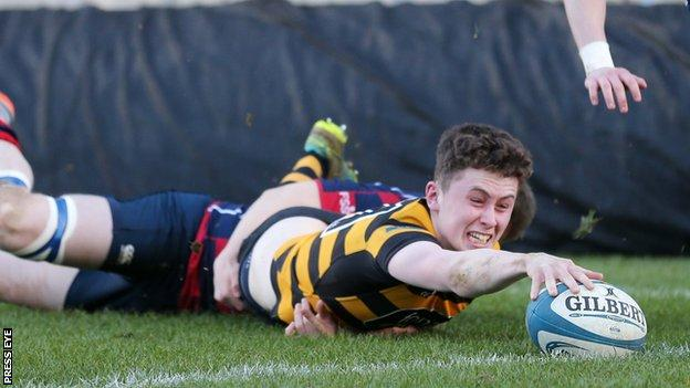 RBAI's Niall Armstrong stretches out to score his second try in the semi-final win over Ballymena Academy