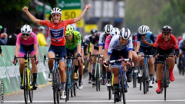Lizzie Deignan celebrates winning the Tour de Suisse as she crosses the line