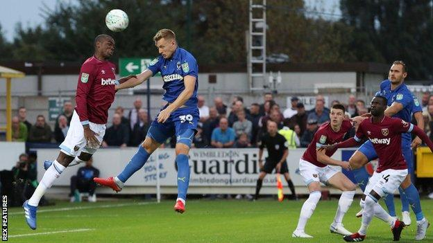 Joe Pigott scores for AFC Wimbledon against West Ham