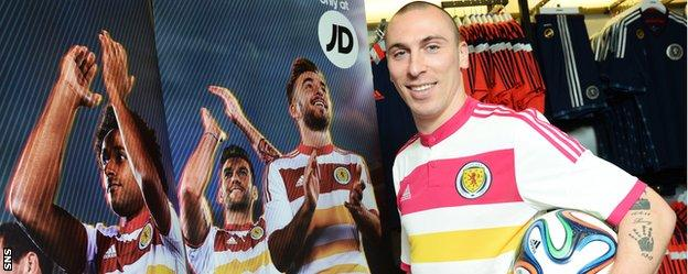 Scotland captain Scott Brown wears the previous away kit