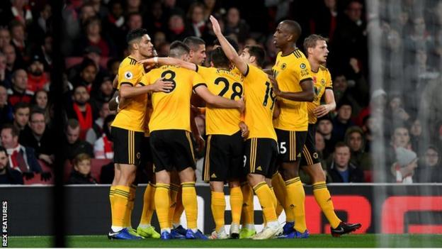 Wolves players celebrate scoring against Arsenal