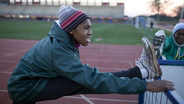 science Caster Semenya stretches before training