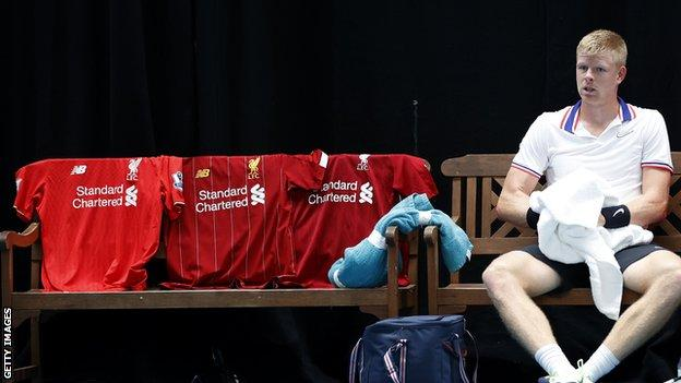 Football fan Kyle Edmund laid out three Liverpool shirts on his bench in celebration of his team's Premier League title win