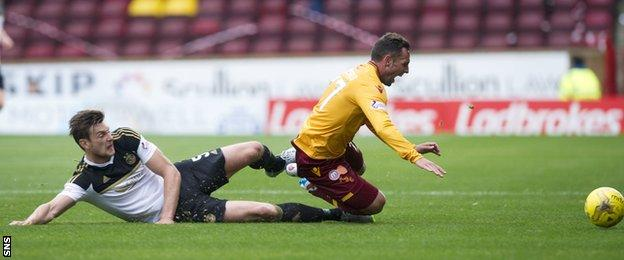 Aberdeen's Ash Taylor tackles Scott McDonald of Motherwell