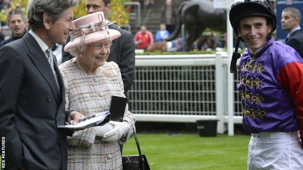 Her Majesty the Queen with racing manager John Warren and champion jockey Ryan Moore