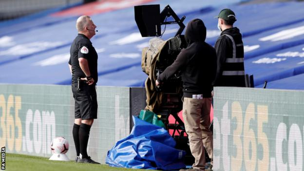 Referee Jonathan Moss reviews an incident on the pitch-side monitor during Crystal Palace's home game with Southampton