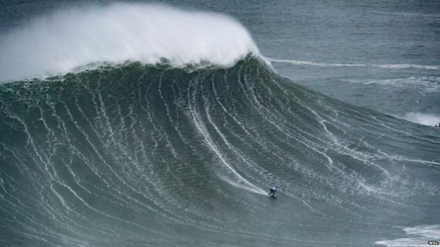 Maya Gabeira surfing a massive wave at Nazare in 2018
