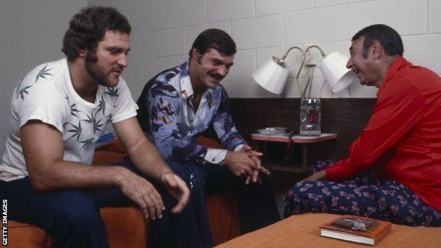 Kiick (left) and Csonka (centre) are interviewed in at the Dolphins' training camp in 1973
