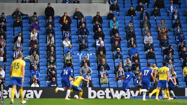 Boris Johnson Socially-distanced fans watch a friendly between Brighton and Chelsea at the Amex Stadium