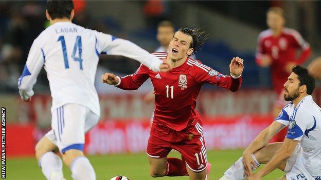 Gareth Bale is brought down by Cyprus midfielder Marios Nikolaou