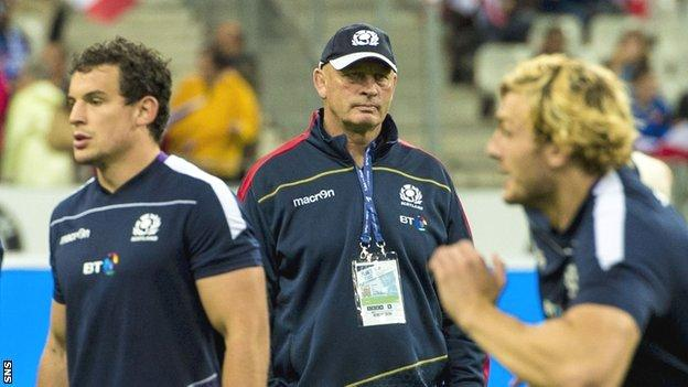 Scotland head coach Vern Cotter watches over his side's warm-up in Paris
