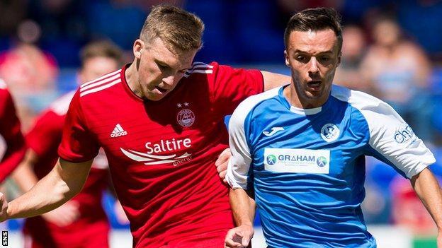 Lewis Ferguson of Aberdeen battles St Johnstone's Stefan Scougall
