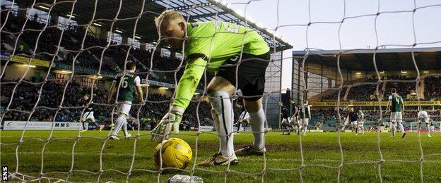 Conrad Logan picks the ball out of the Hibs net
