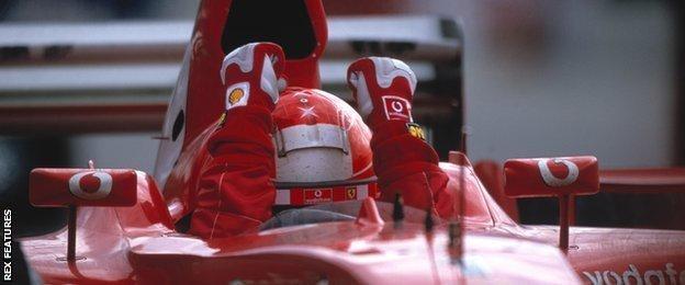 Schumacher celebrates winning the 2003 US Grand Prix