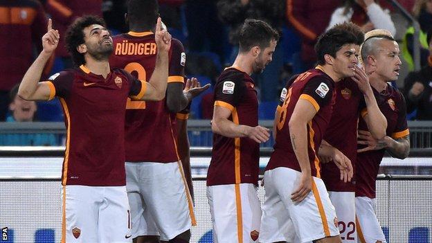 Mohammed Salah (left) celebrates scoring against Fiorentina