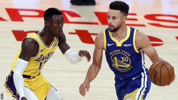 Stephen Curry in action against the Los Angeles Lakers' Dennis Schroder
