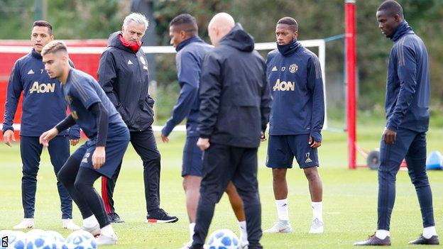 Manchester United manager Jose Mourinho watches his players train