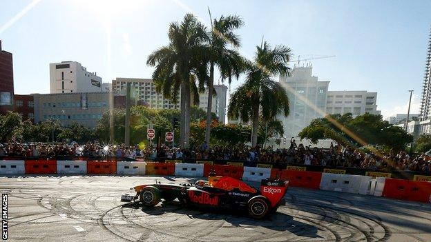 Red Bull Racing driver Patrick Friesacher does donuts during the Miami F1 festival in October 2018