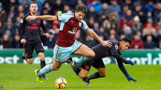 Burnley defender James Tarkowski challenges Arsenal's Alexis Sanchez