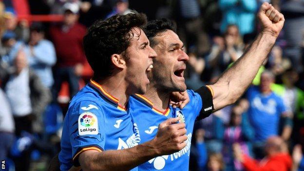 Jaime Mata celebrates with teammate Jorge Molina
