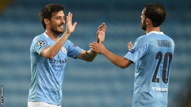 David Silva high fives a Manchester City team-mate