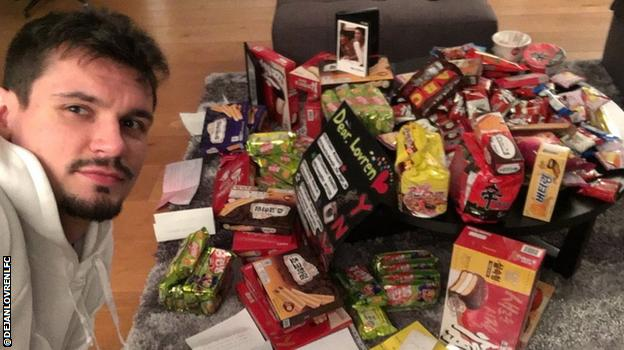 Dejan Lovren with loads of biscuits and sweets