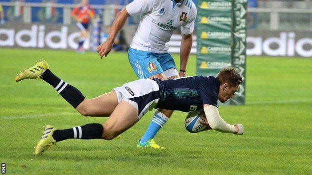 Henry Pyrgos scores a try for Scotland against Italy