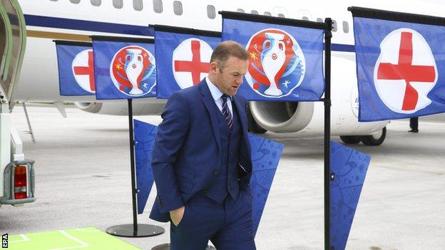 England captain Wayne Rooney leaves the plane as it lands at the Le Bourget Airport in Paris