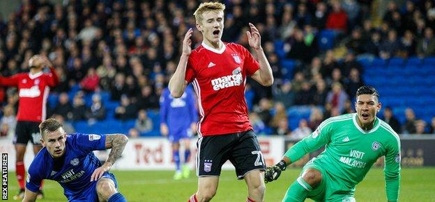 Ipswich's Flynn Downes reacts after his goal-bound shot was blocked by Joe Ralls