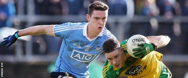 Donegal's Ciaran Thompson attempts to burst away from Dublin's Brian Fenton at Ballybofey