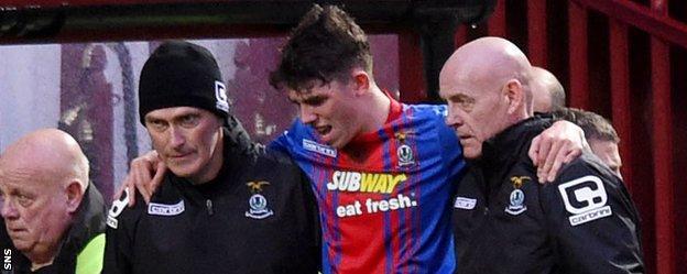 Inverness midfielder Ryan Christie is helped off against Motherwell