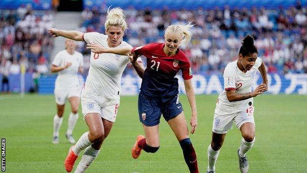 Millie Bright and Demi Stokes close down a Norway defender at the Women's World Cup