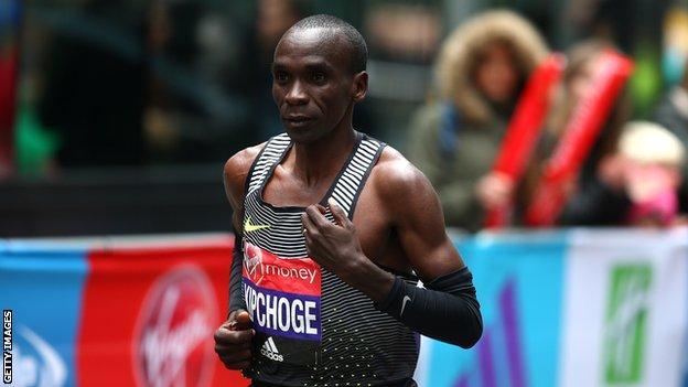 Eliud Kipchoge crosses the finishing line