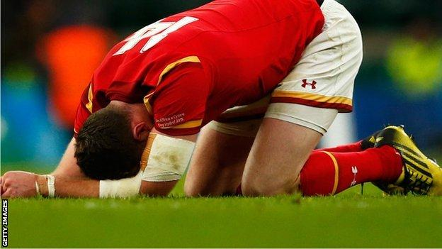 Alex Cuthbert sinks to the ground after Wales' World Cup defeat by South Africa