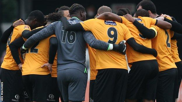 Maidstone United players huddle together