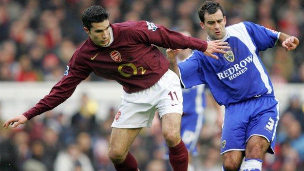 Chris Barker challenges Arsenal's Robin van Persie during his playing career
