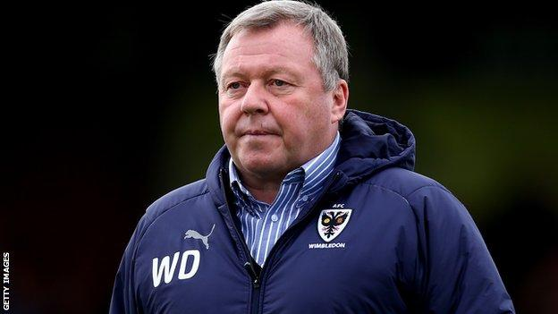 AFC Wimbledon manager Wally Downes on the sidelines