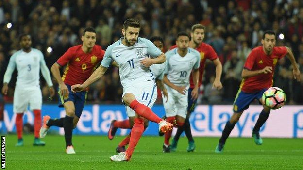 Adam Lallana scores a penalty to give England the lead against Spain