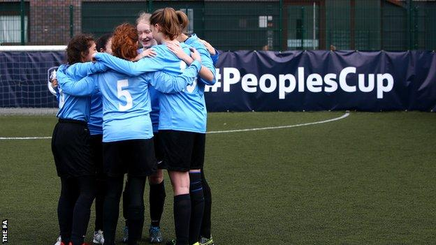 Girls football team huddle
