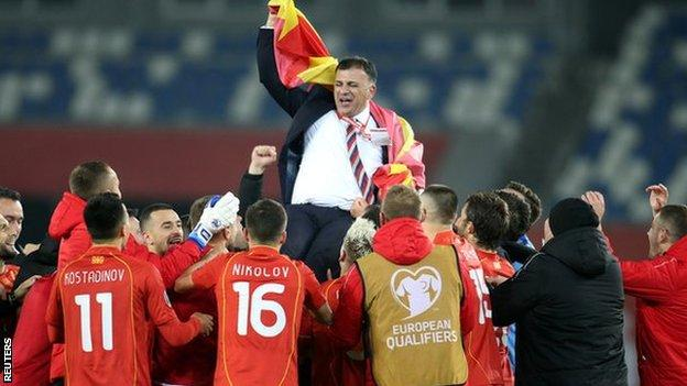 North Macedonia coach Igor Angelovski celebrates with his players after qualifying for Euro 2020