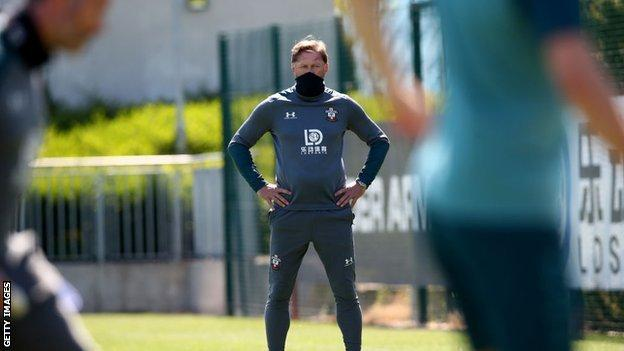 Southampton boss Ralph Hasenhuttl covered his mouth with a snood as he watched his players take part in Tuesday's training session