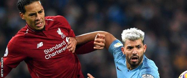 Liverpool's Virgil van Dijk challenges Sergio Aguero of Manchester City