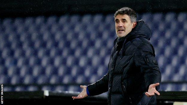 Former Dinamo Zagreb head coach Zoran Mamic holds his hands out as he gestures from the touchline during a Europa League tie