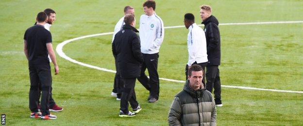 Celtic manager Ronny Deila and players get a feel for the playing surface at New Douglas Park