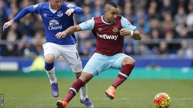 Dimitri Payet evades the challenge of James McCarthy