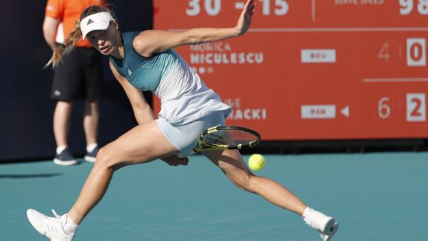 "Caroline Wozniacki of Denmark in action against Monica Niculescu of Romania during their women""s singles match at the Miami Open tennis tournament in Miami, Florida, USA, 23 March 2019. EPA/RHONA WISE"